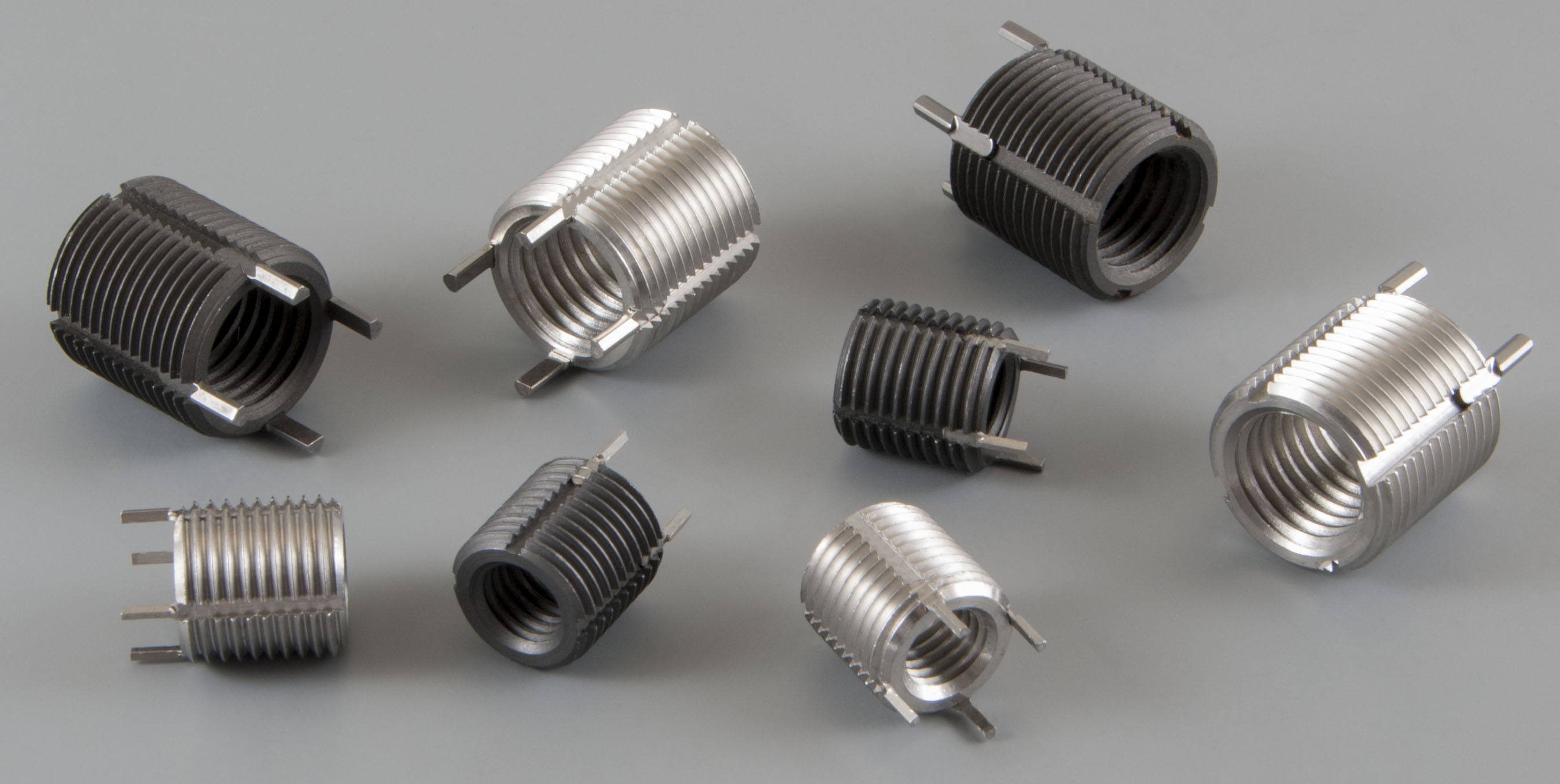 Thread repair kits and threaded inserts