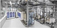 Fully automatic multi-medium testing facility for fluidic components