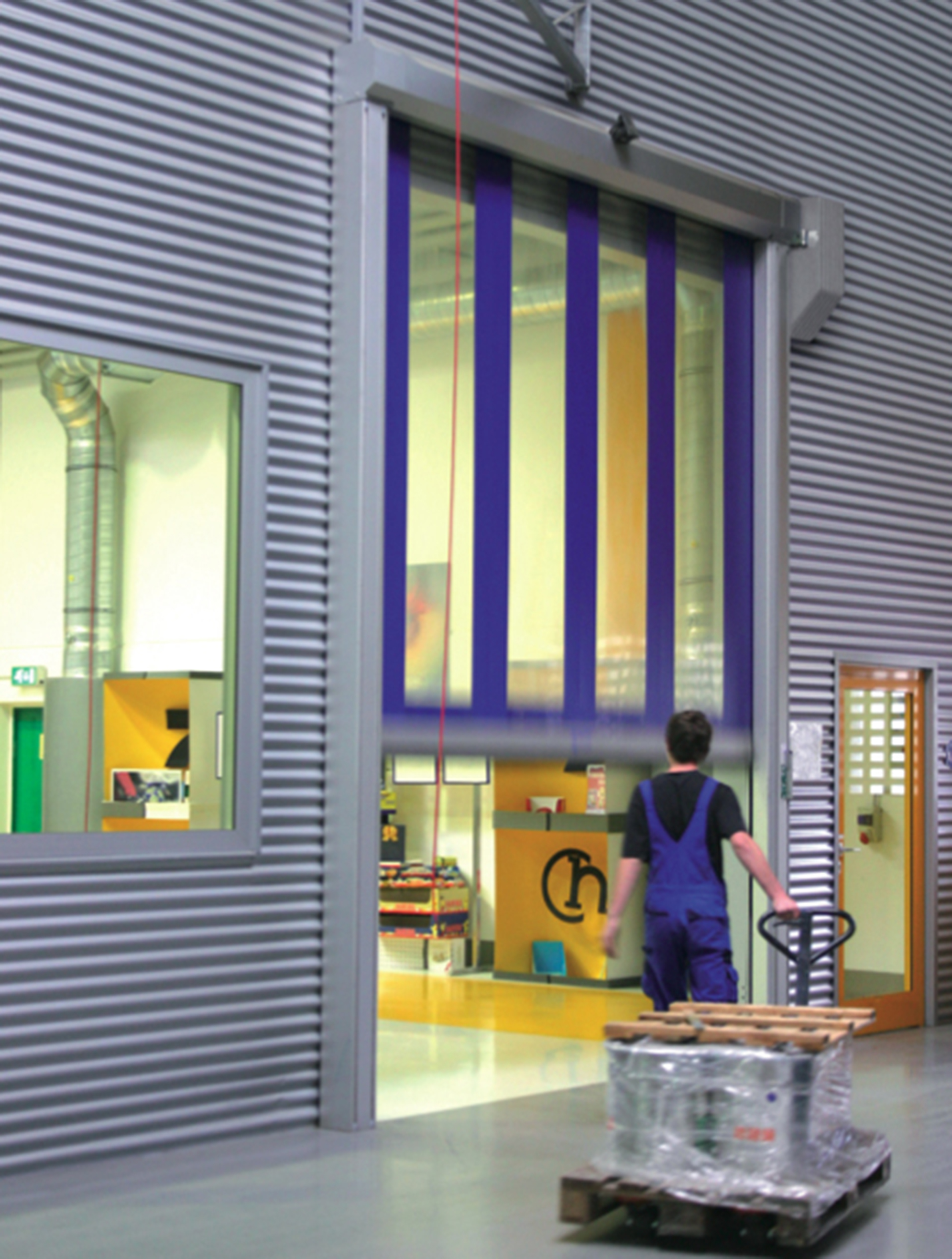 sara LBS roller shutter doors keep winter weather out at Glasgow paper plant