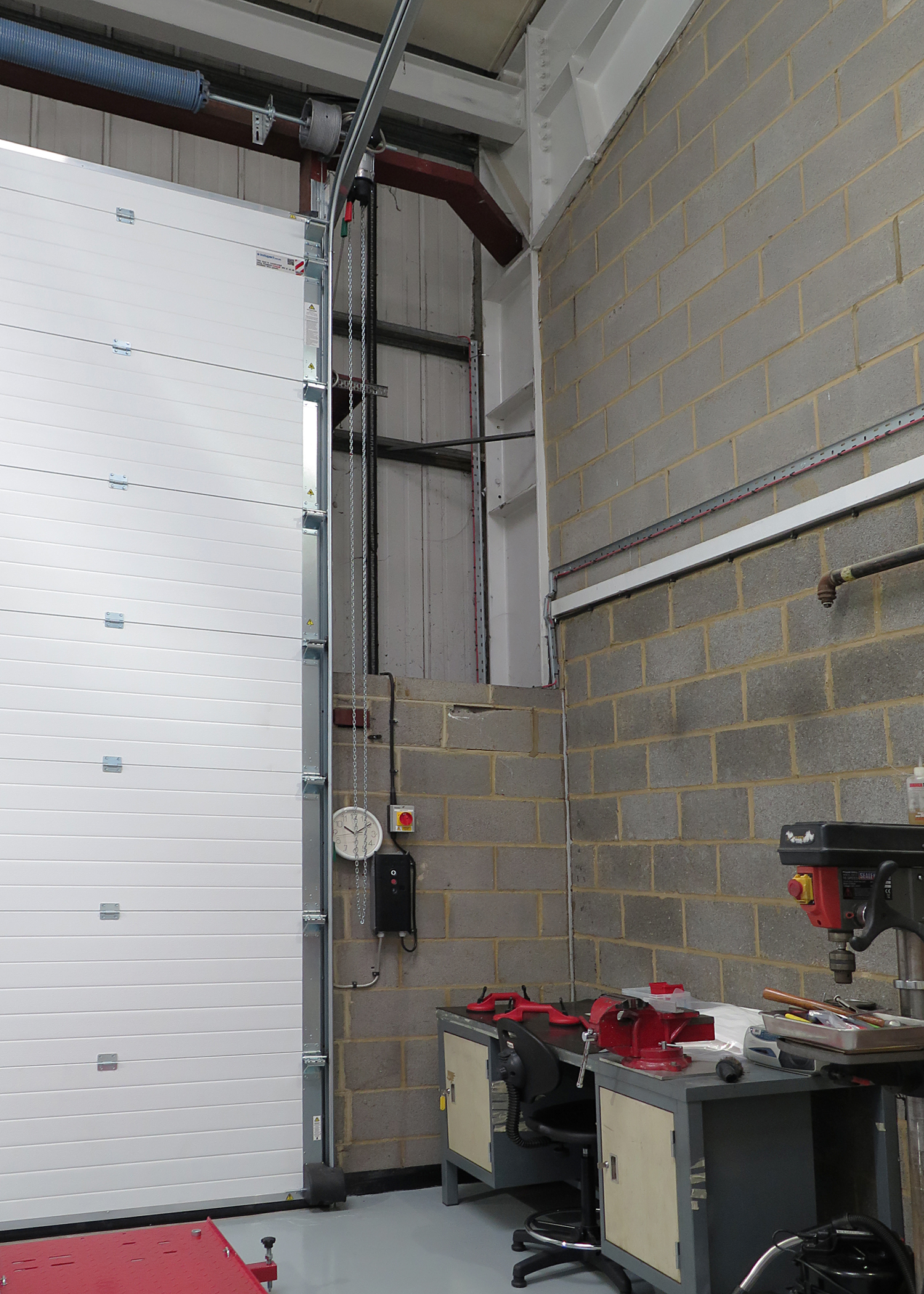 Insulated industrial doors help create efficient and prestigious headquarters and laboratory for high-tech company